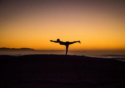 Yoga Virabhadrasana III, warrior pose at the sunrise
