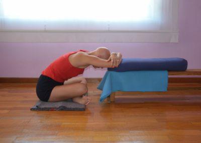 Yoga Adho Mukha Swastikasana with the forehead suported