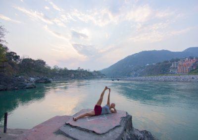 Yoga Anantasana, Visnu pose, by the Ganges in Rishikesh, India