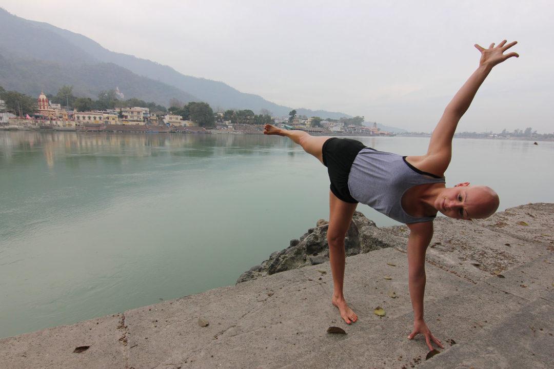 Yoga Ardha Chandrasana, Half moon pose by the Ganges in Rishikesh, India