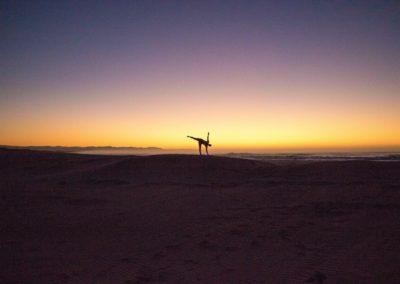 Yoga Ardha Chandrasana, half moon pose at the sunrise