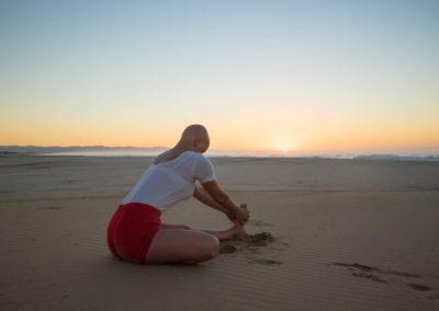 Yoga Maha mudra by the sea