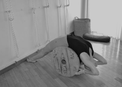 Yoga Viparita Dandasana using a roll