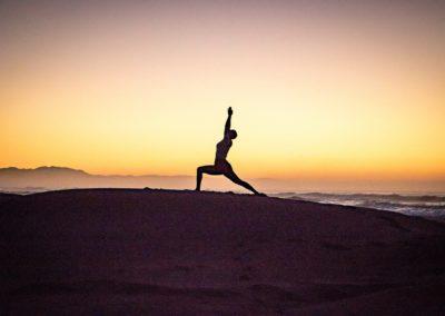 Yoga Virabhadrasana I, warrior pose at the sunrise